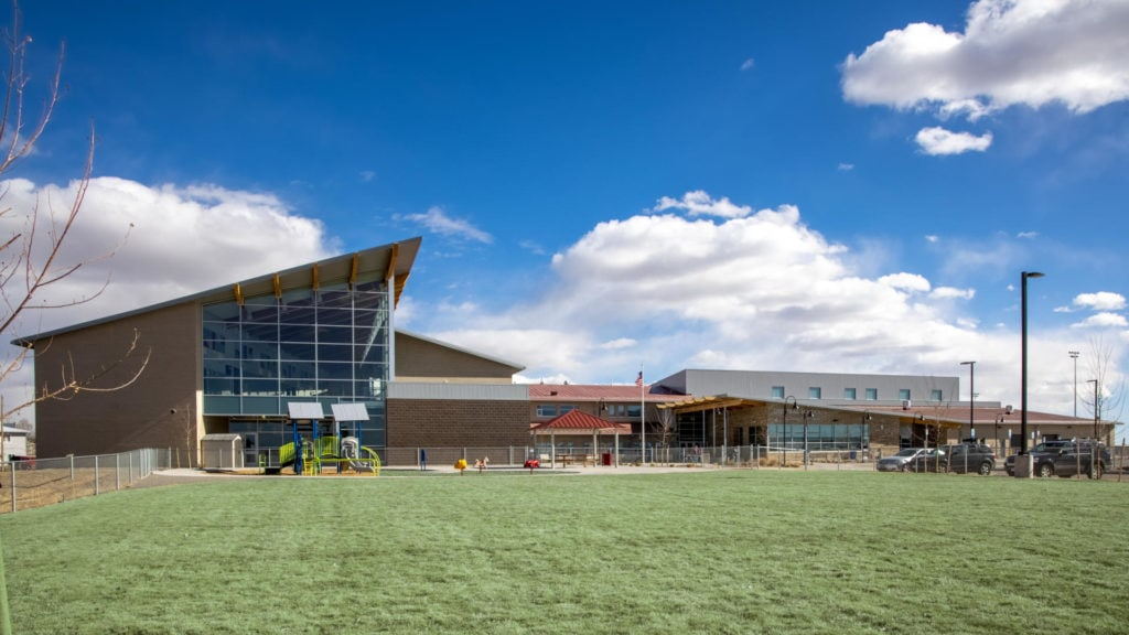 To meet requirements for the State of Colorado's High Performance Certification Program, Iconergy proposes to provide commissioning services equal to LEED v4 (Fundamental and Enhanced Cx) or CHPS Verified through the Collaborative for High Performance Schools. As the project design has yet to begin, plans are currently on this 74,250 SF school of medium complexity (VAV rooftop units with heating and chilled water plants, no renewable energy systems). The certification process dictates which equipment must be commissioned. Under a CHPS program the scope must include HVAC mechanical systems/equipment, the domestic hot water heating plant and automated lighting controls. LEED v4 includes the systems required under CHPS, as well as power distribution systems.